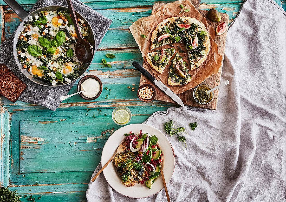 Healthy brunch - shakshuka, cauliflower pizza with pesto and figs and qorn meatloaf