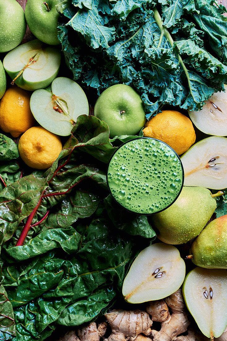 Fresh detox juice with pears, apple, lemons, ginger, chard and kale