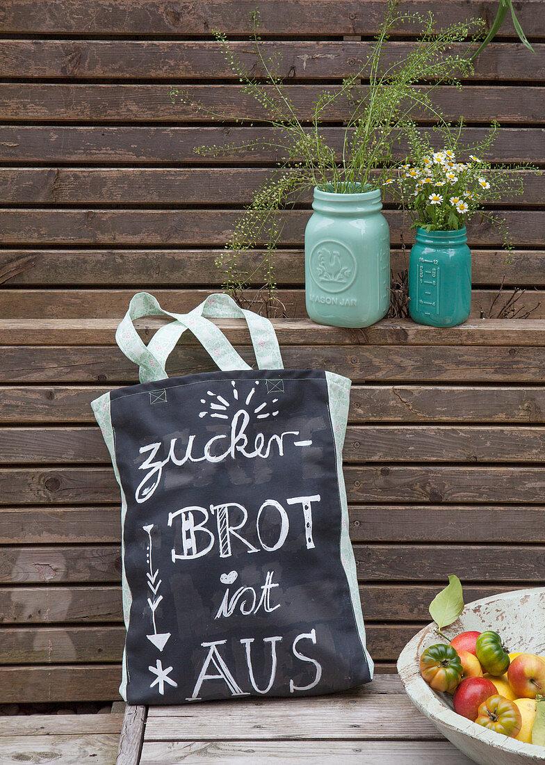 Motto written on bag handmade from chalkboard fabric
