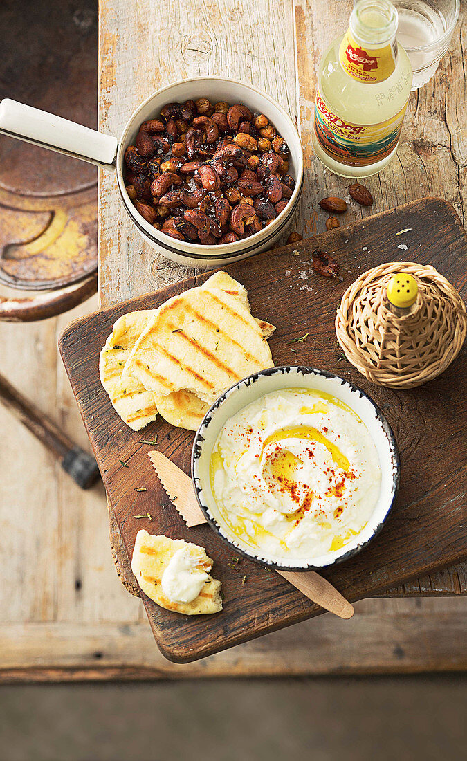 Spicy chickpea and nut mix, Grilled flatbread with lemon fetta dip