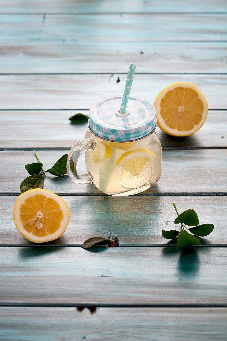 Diet lemonade made with apple vinegar, ginger, lemon and honey
