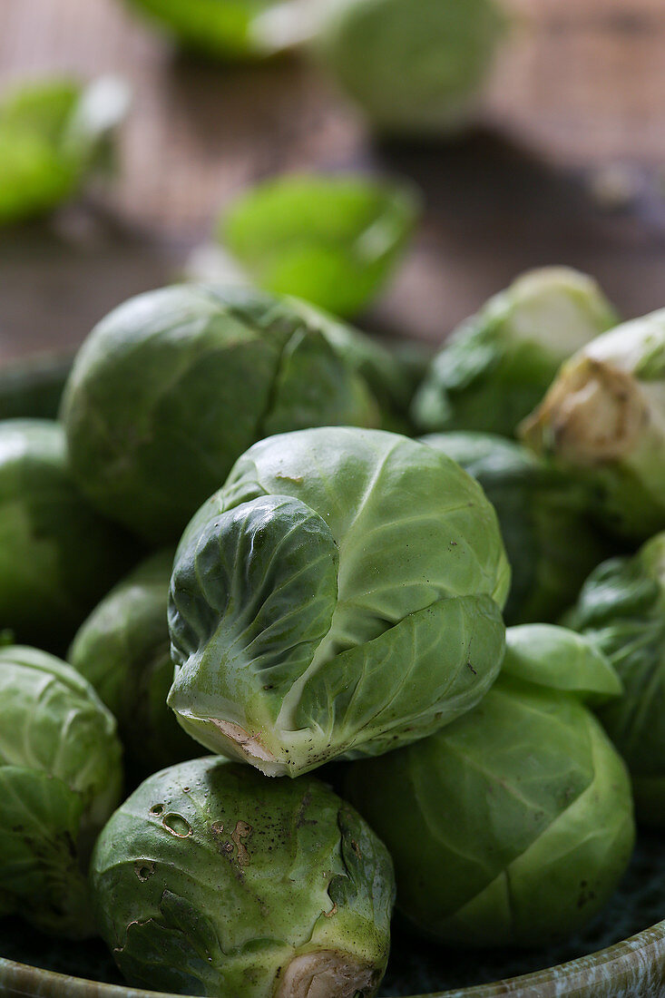 Fresh Brussels sprouts in a small bowl (close up)
