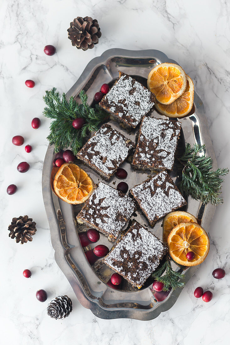 Christmas poppy seed and orange tray cake on a platter