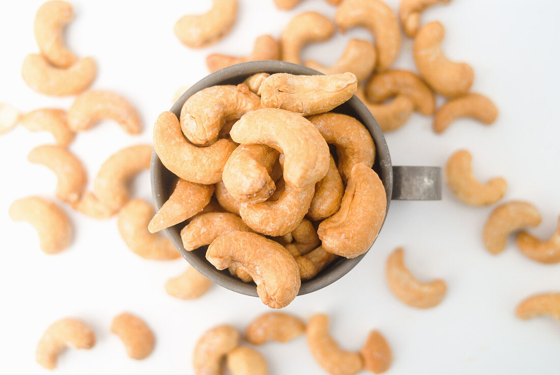 Cashew kernels in a metal cup