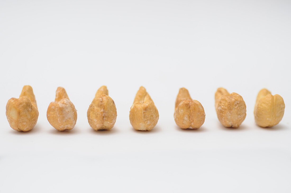 Roasted and salted cashews in a row