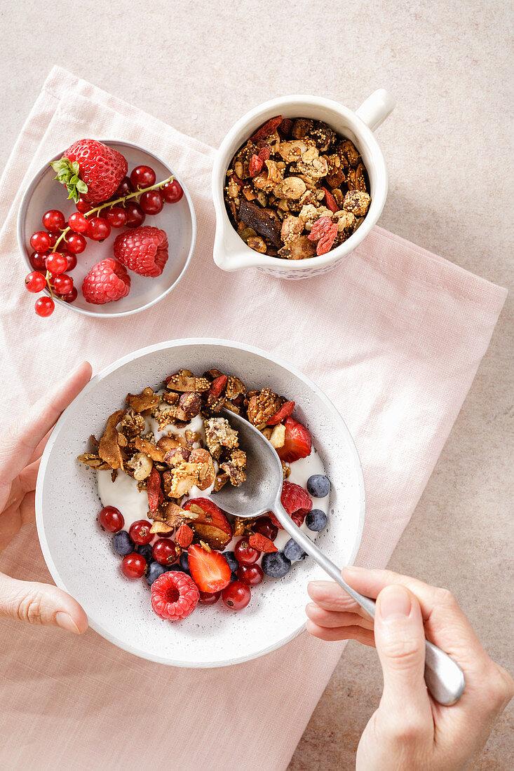 Low-carb nut granola muesli with berries