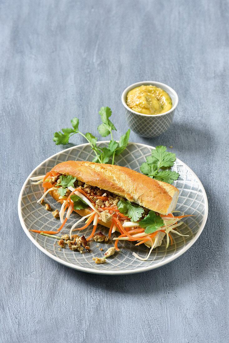 A Vietnamese sandwich with tofu and mustard mayonnaise