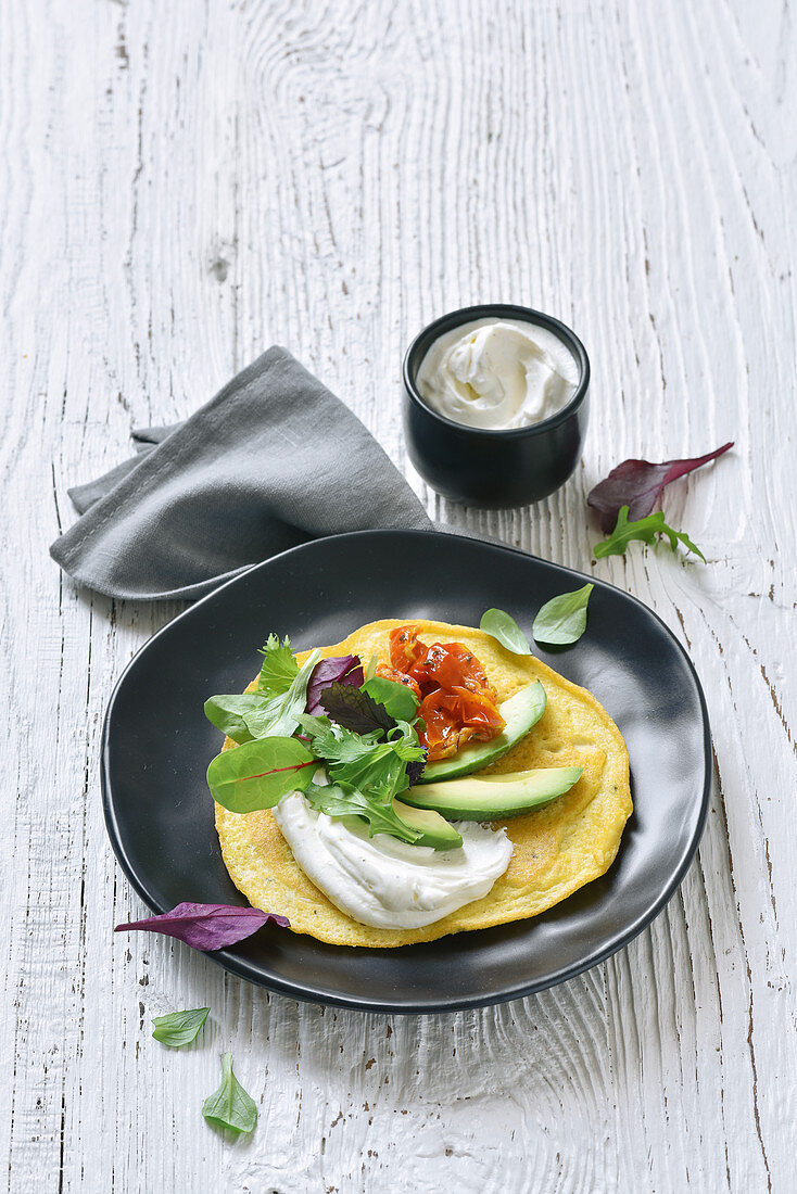 A socca wrap with goat's cheese and avocado