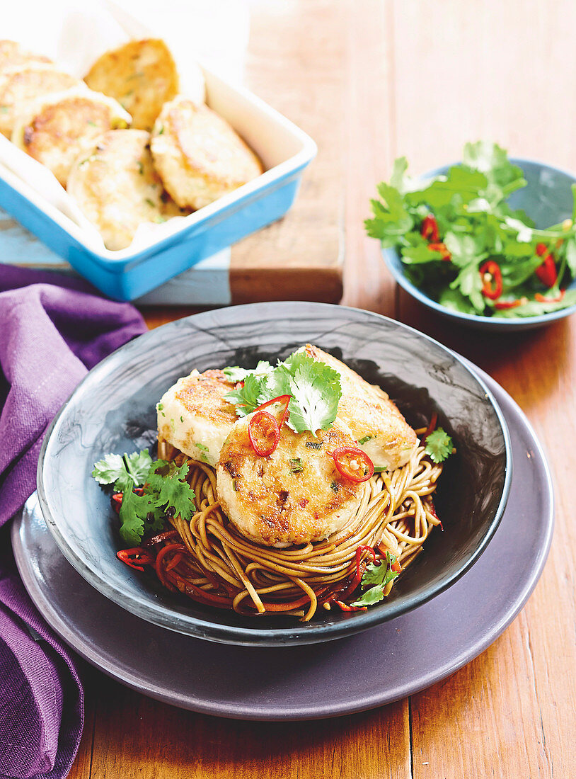 Asian-stlye fishcakes with sesame and soy soba noodles
