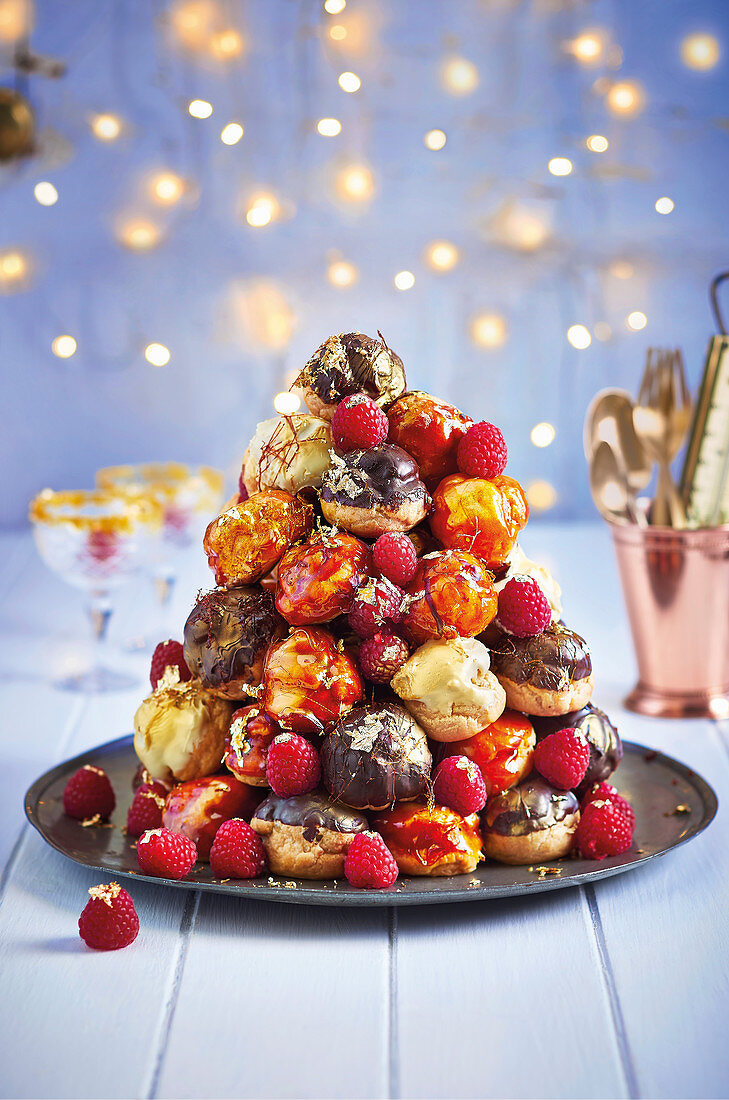 Caramel and double chocolate profiterole tower with copper bling