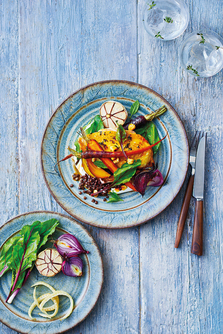 Free range harissa roast chicken and root vegetable salad including carrots garlic beetroot and onions. Dressed with lentils toasted hazlenuts yoghurt beetroot leaves mint and chilli oil