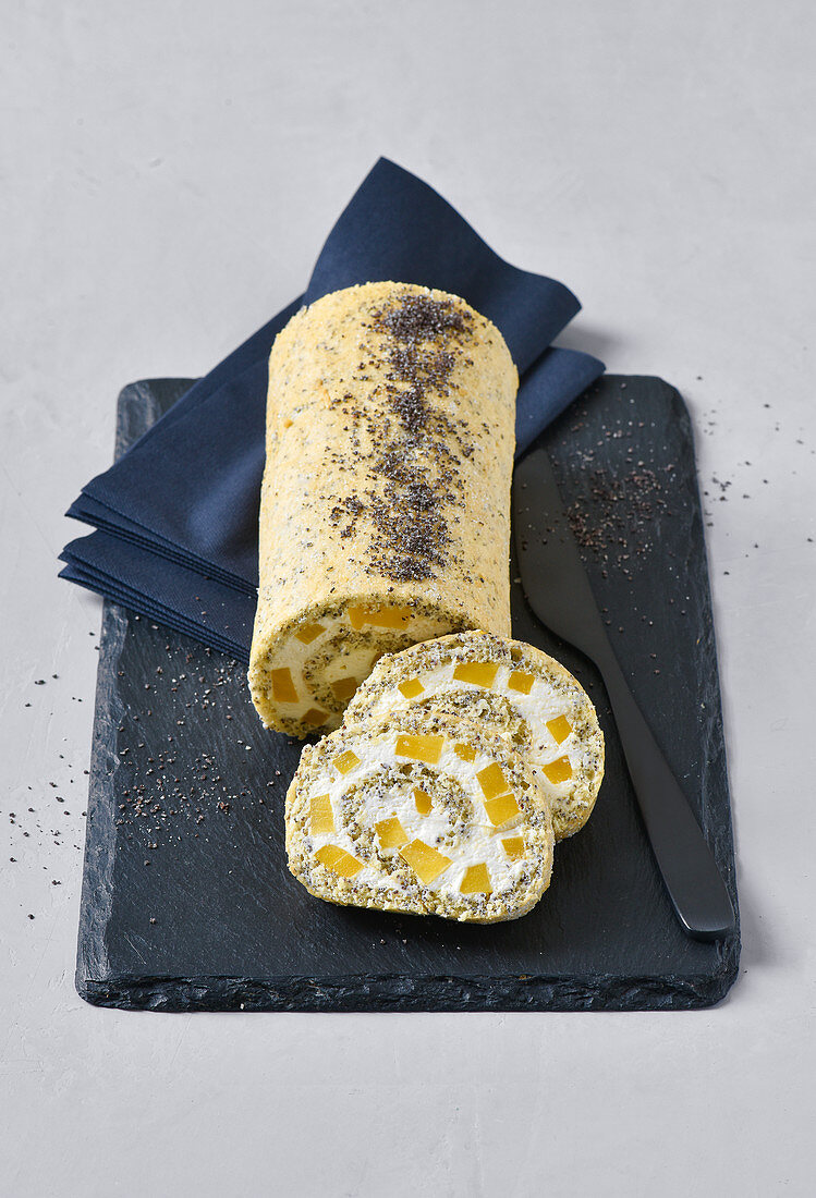 A poppy seed roll filled with mango cream