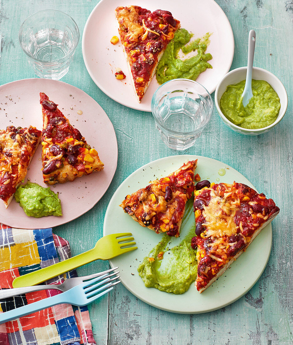 Texmex pizza slices with a pea dip