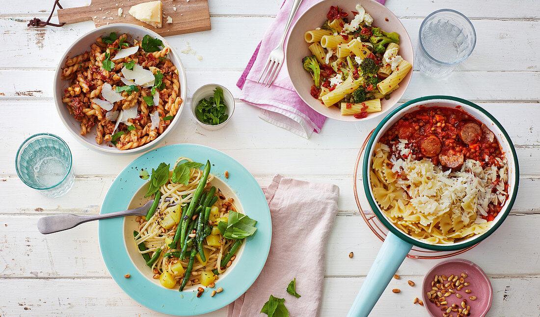 Gemelli pasta with nut pesto, pasta alla genovese, broccoli tortiglioni, and pasta with lentil bolognese