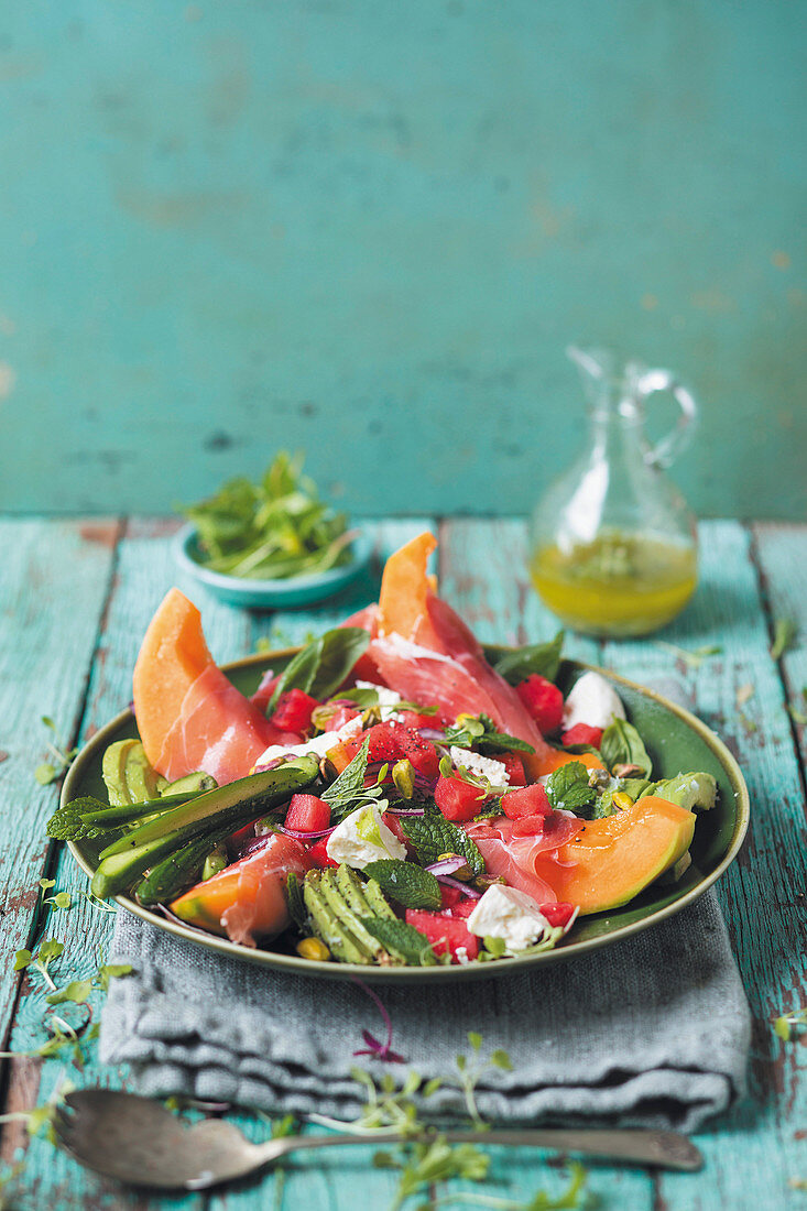 Fruity summer salad with melon, Parma ham and feta