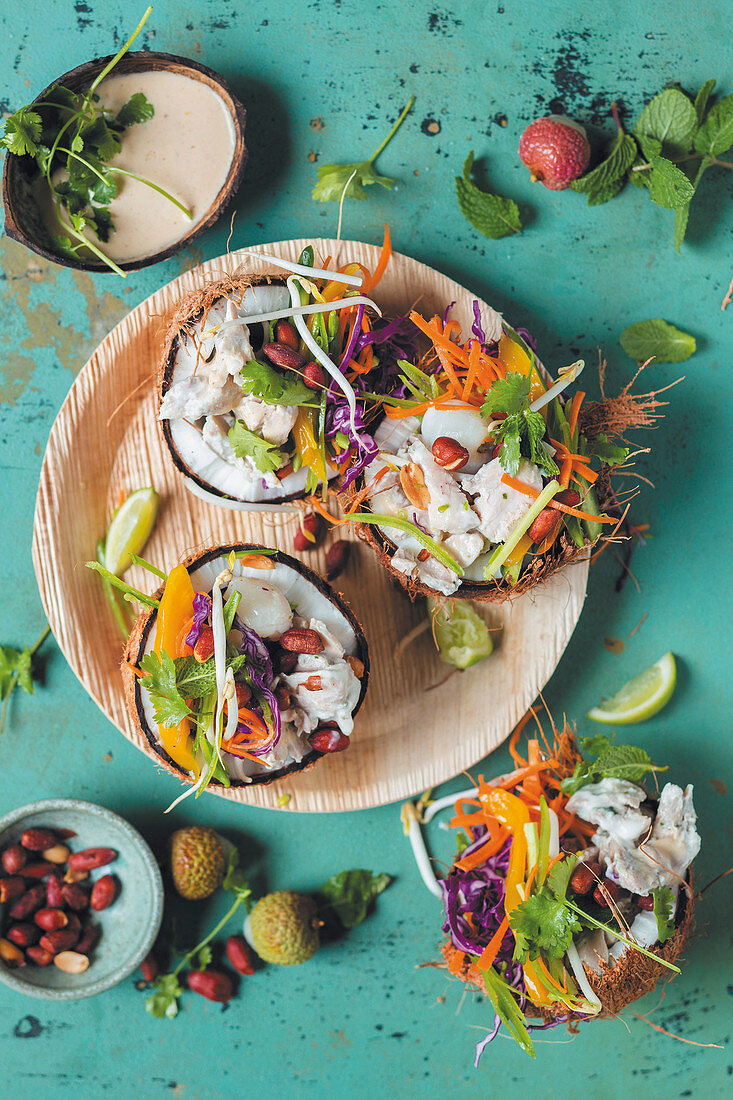 Thai Chicken Vegetable Salad in coconut shell
