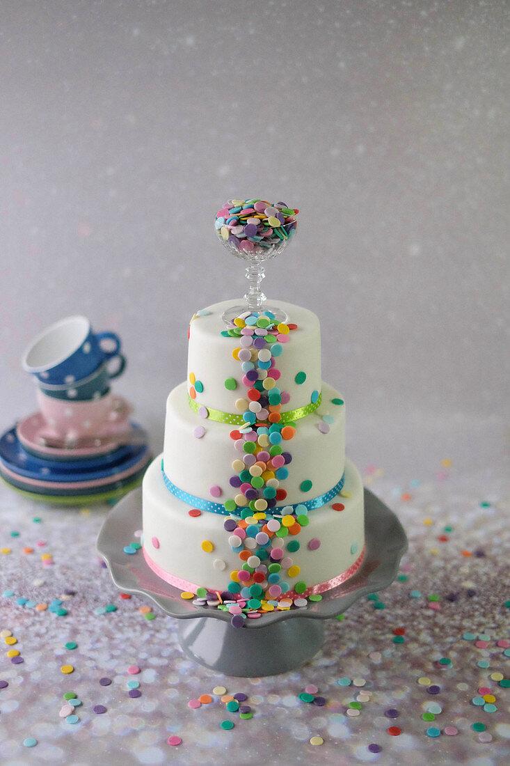 A colourful three-tier confetti cake