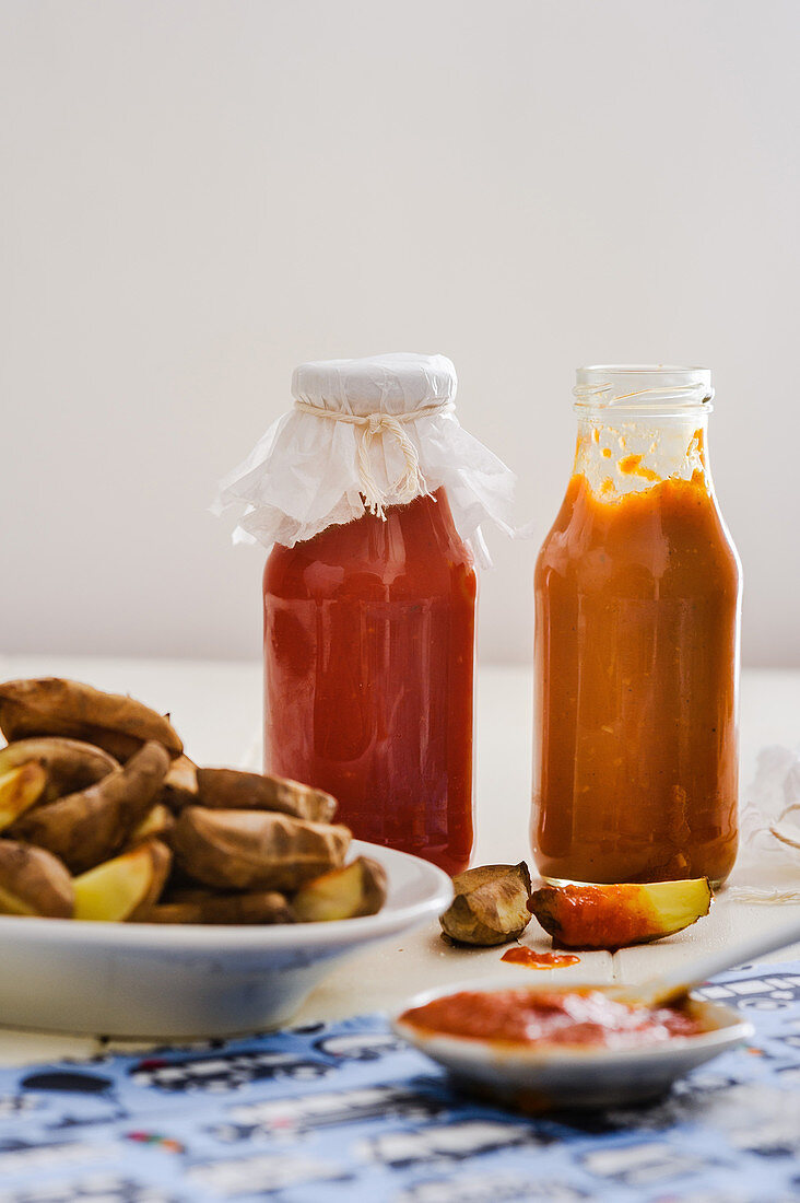 Tomato ketchup and curry ketchup with potato wedges