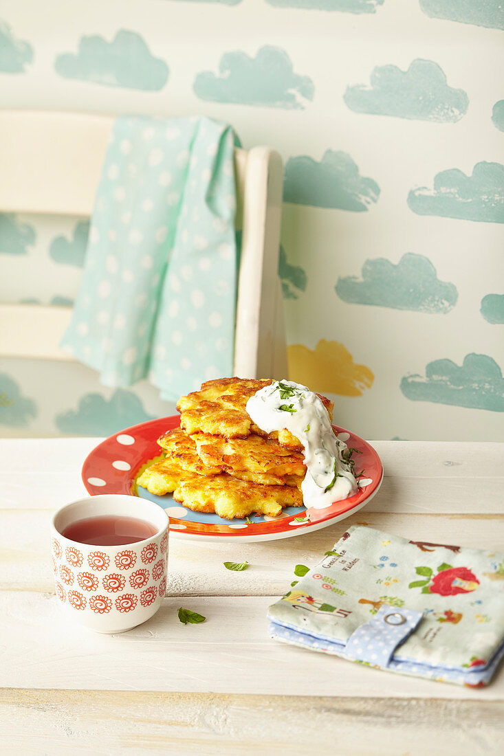 Potato and carrot fritters with herb quark