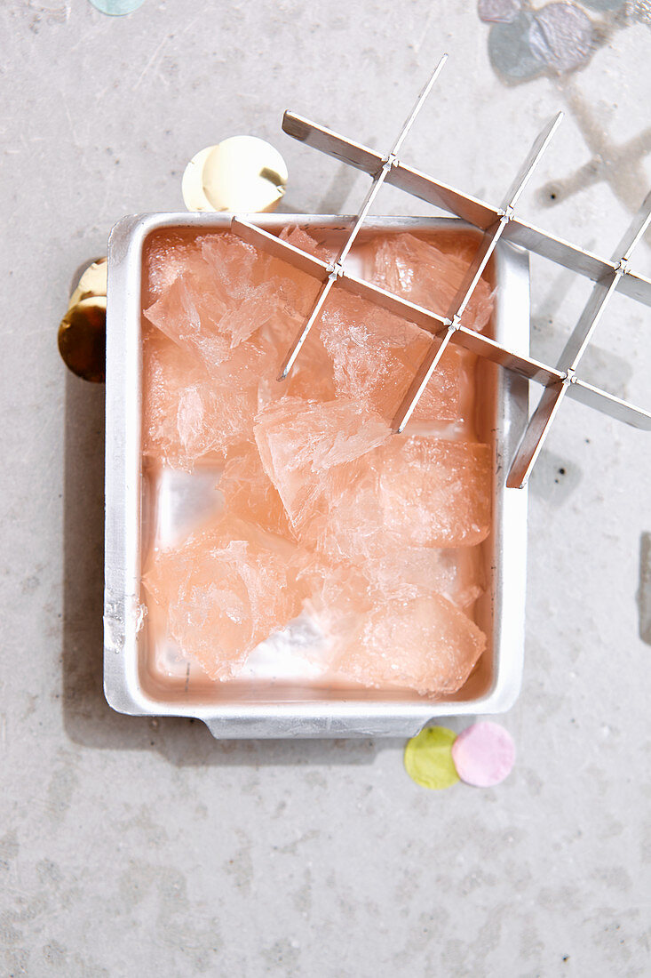 Rosé wine ice cubes and ice splinters in a ice cube tray