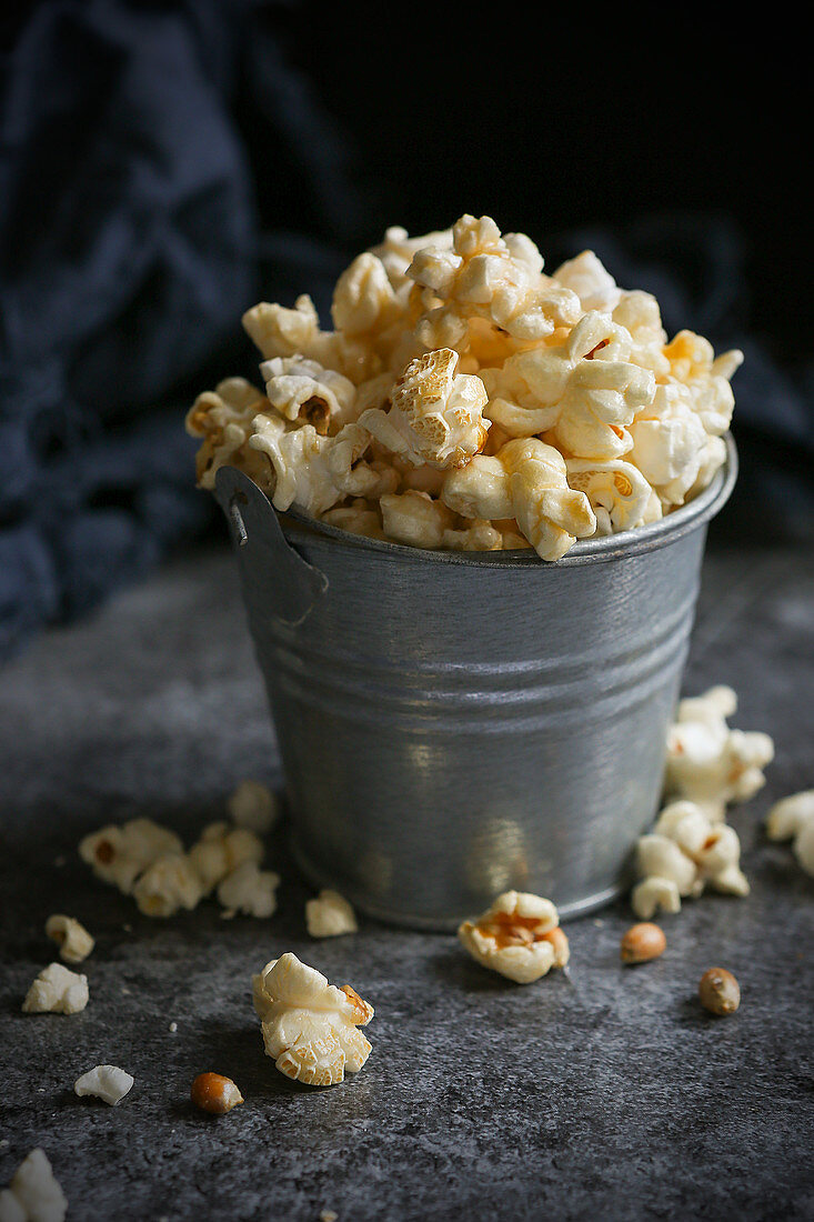 Popcorn in a small metal bucket