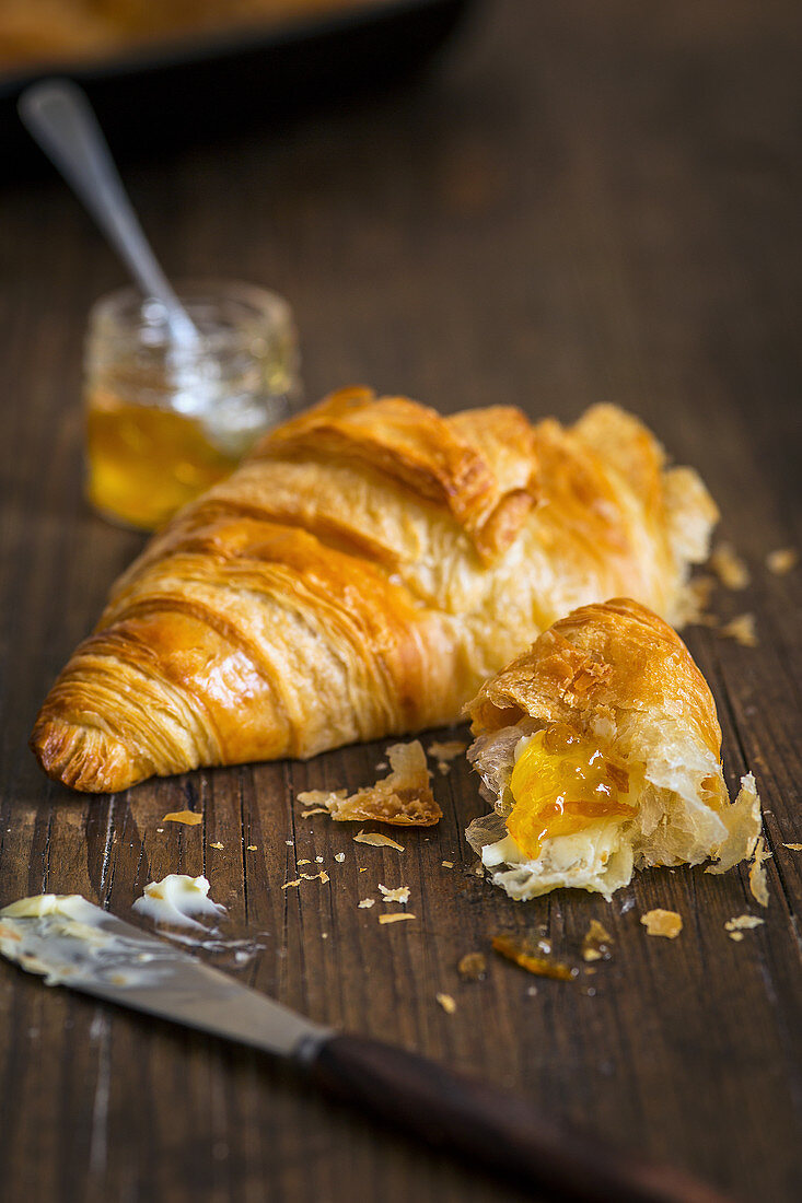 A croissant with orange marmalade (close up)