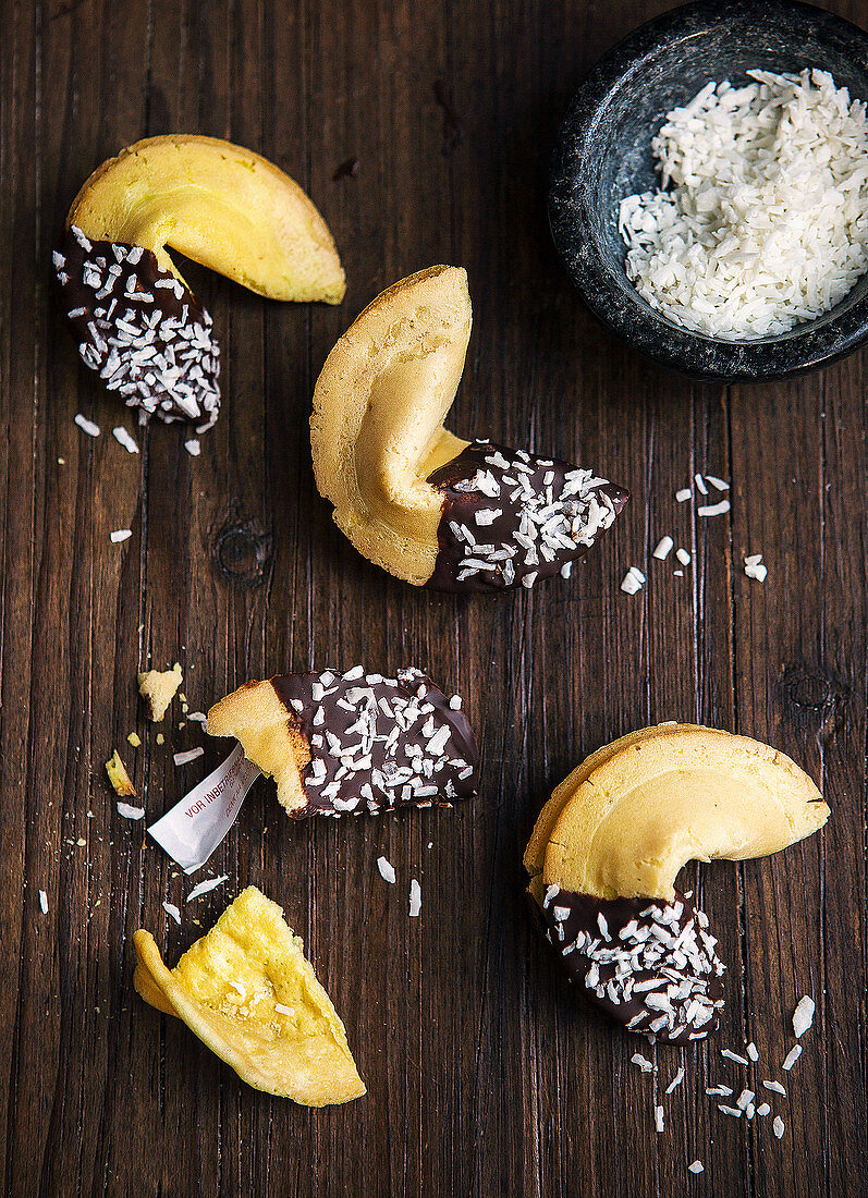 Fortune cookies with chocolate icing and grated coconut (top view)