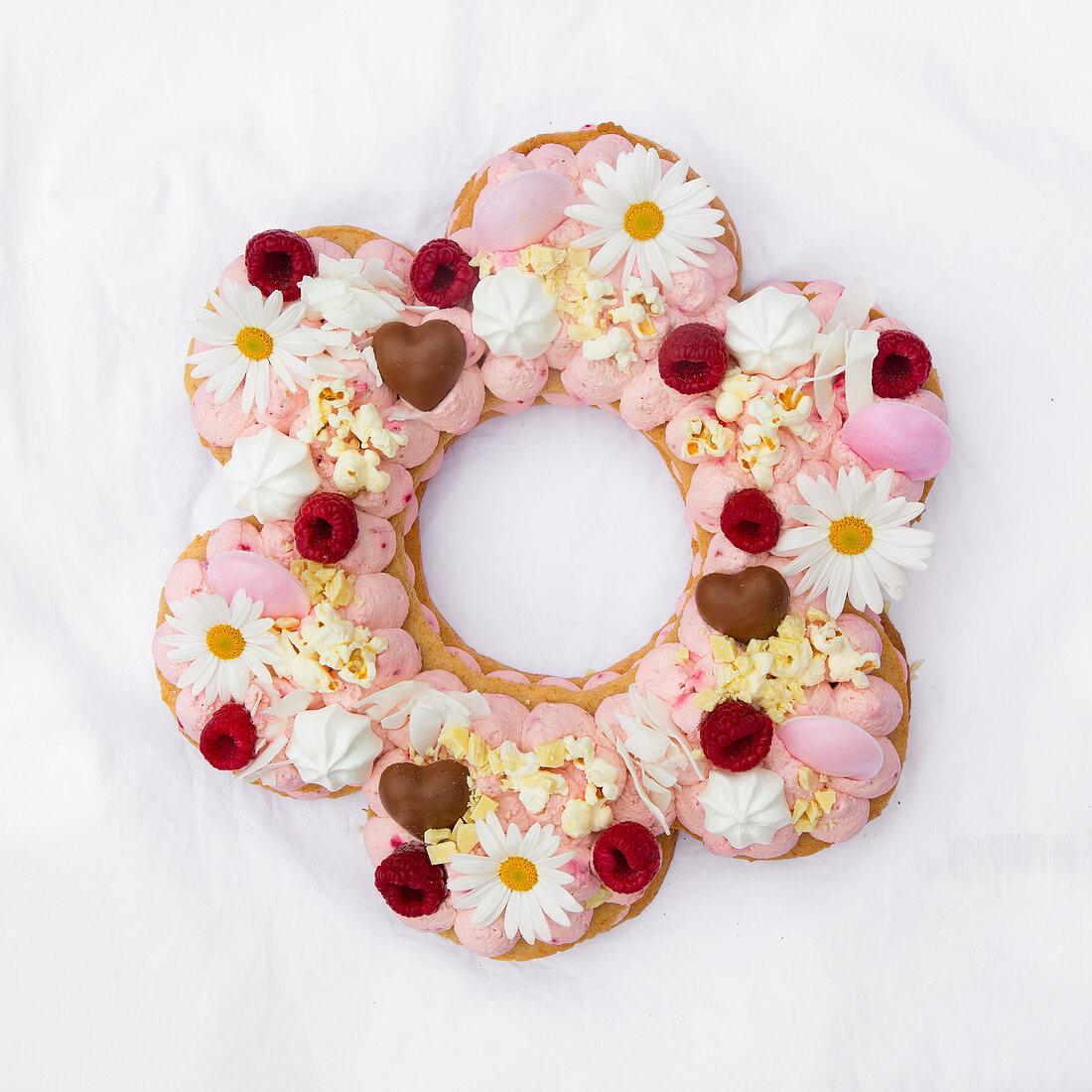 A lavishly decorated flower-shaped cake with raspberry mascarpone cream