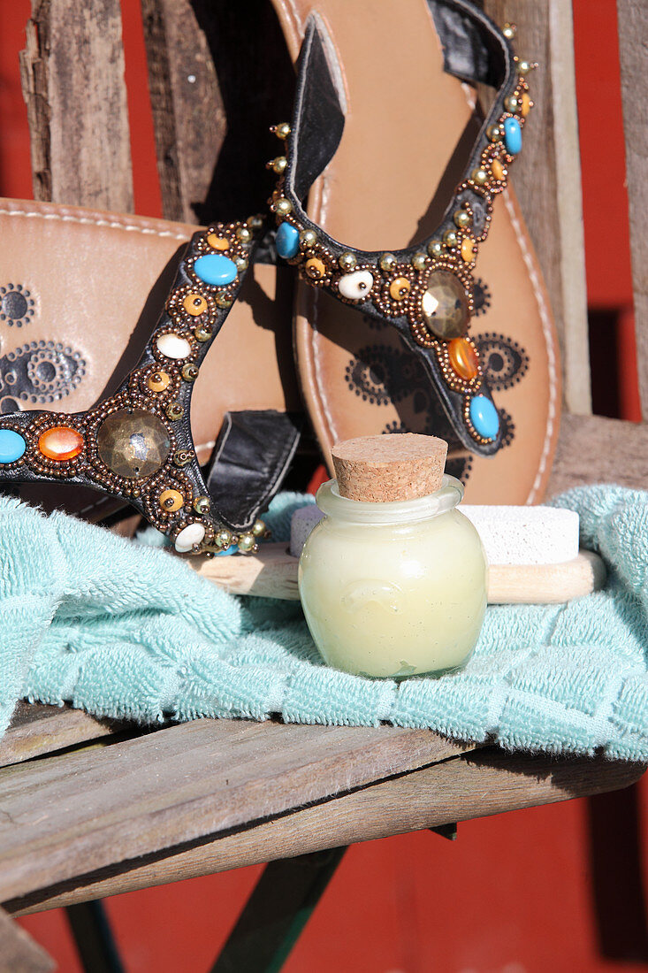Homemade foot balsam made from dried herbs and shea butter