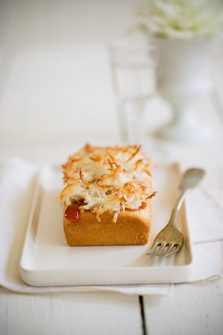 Coconut cake with raspberry sauce