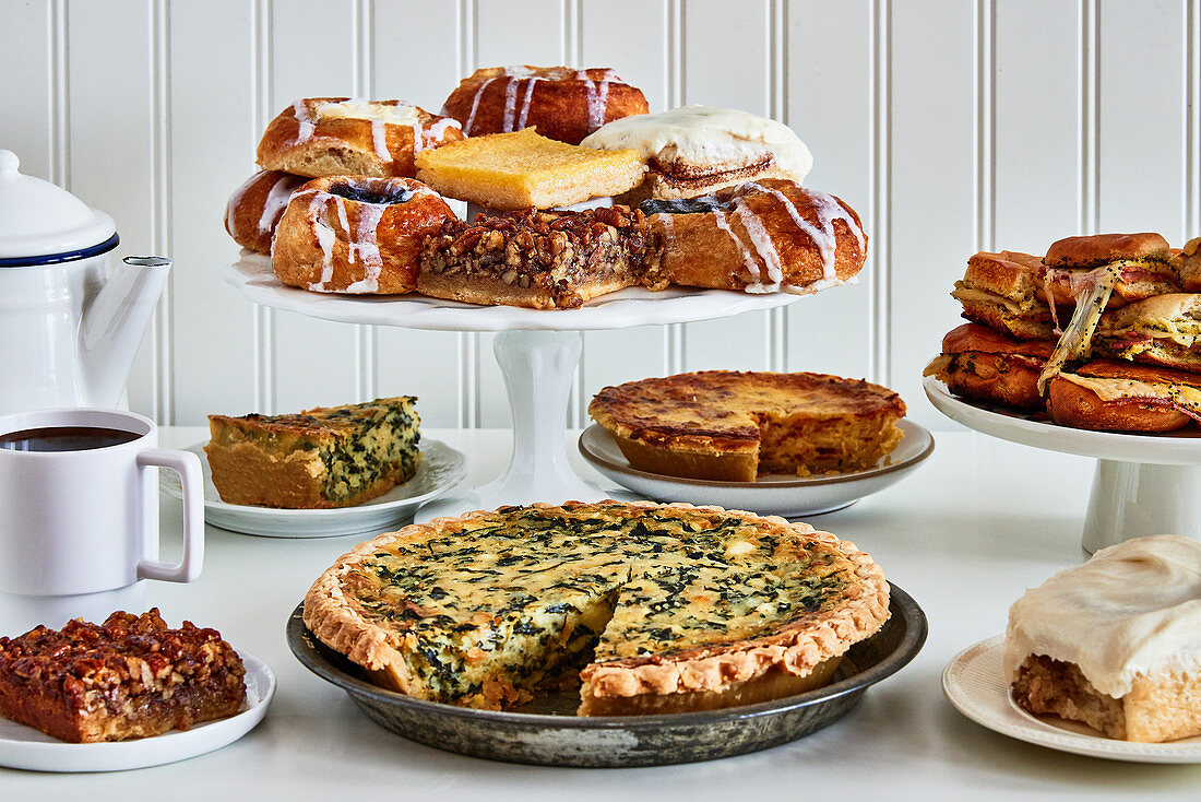 Pie and cinnamon buns on a cake buffet