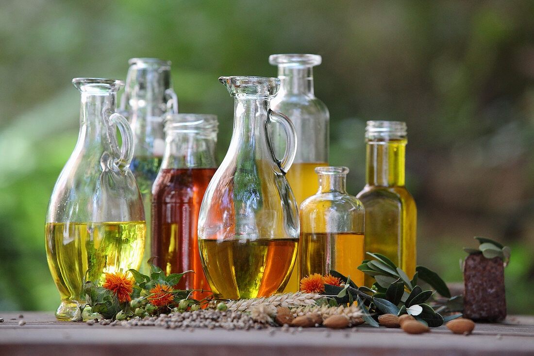Various oils and oil extracts in bottles and carafes