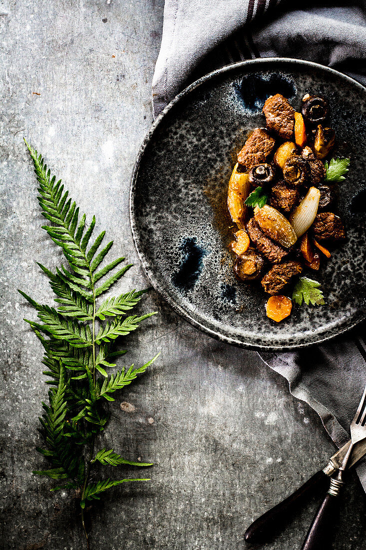 Braised beef with shallots, carrots and mushrooms