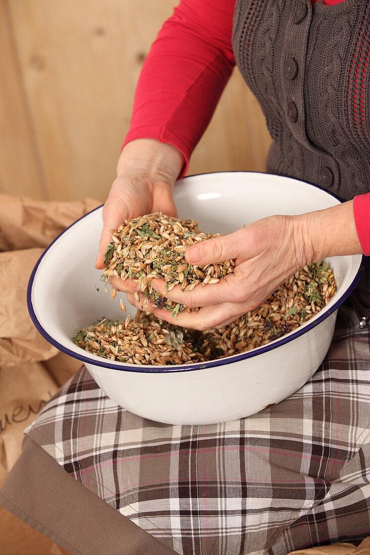 Spelt husks and herbs for making herbal pillows