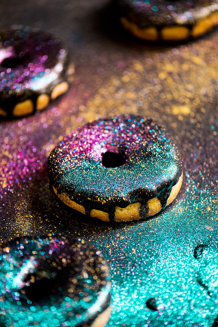 Donuts with chocolate icing and glitter