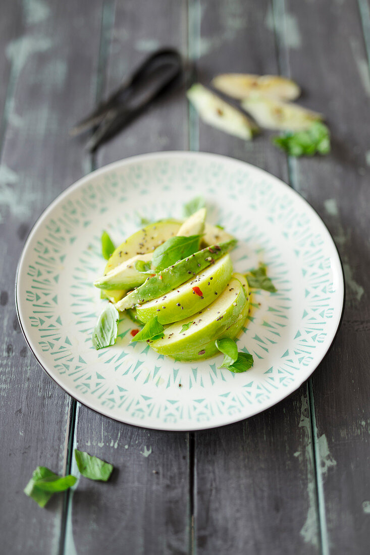 Quick apple salad with avocado, chili and chia seeds (vegan)
