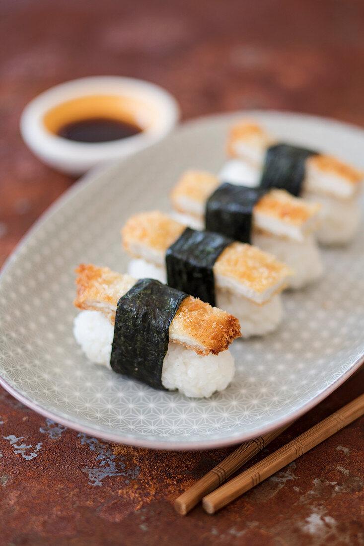 Nigiri sushi with crispy chicken strips