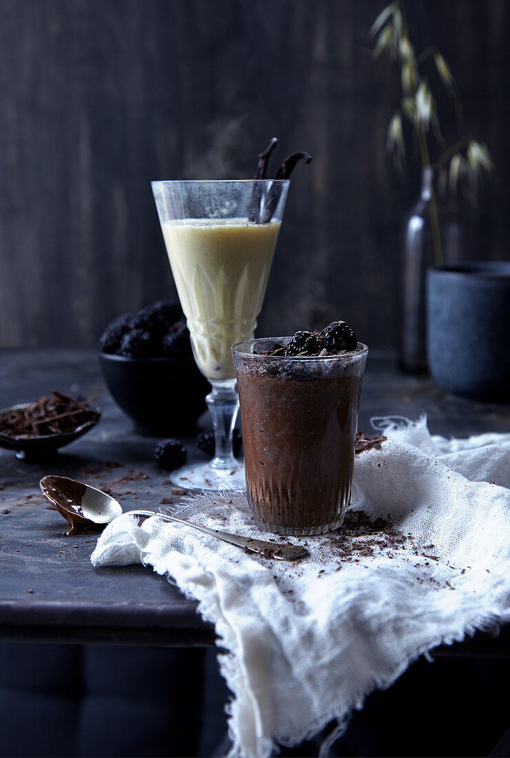 Dark chocolate pudding in a glass with a vanilla drink