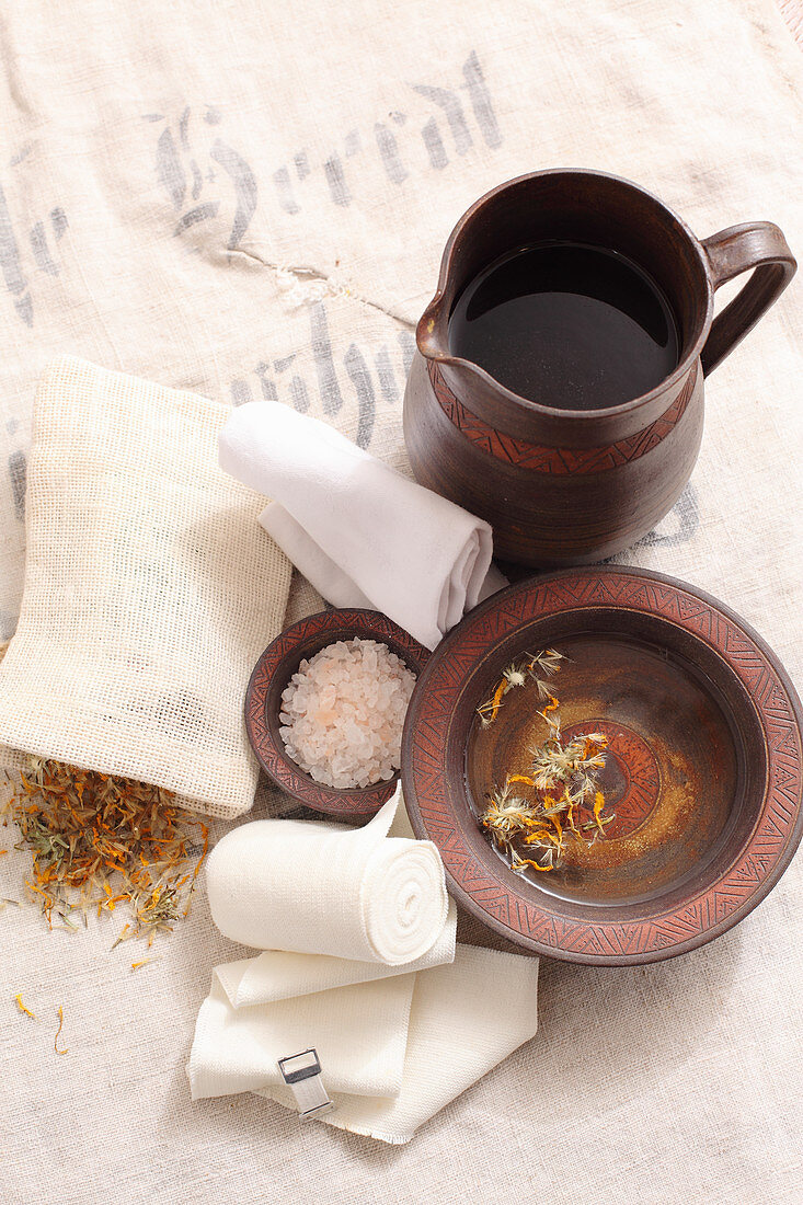 The ingredients for a salt wrap with Arnica flowers