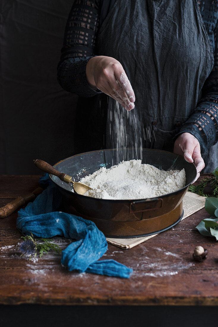 A woman preparing dough for gingerbread cookies