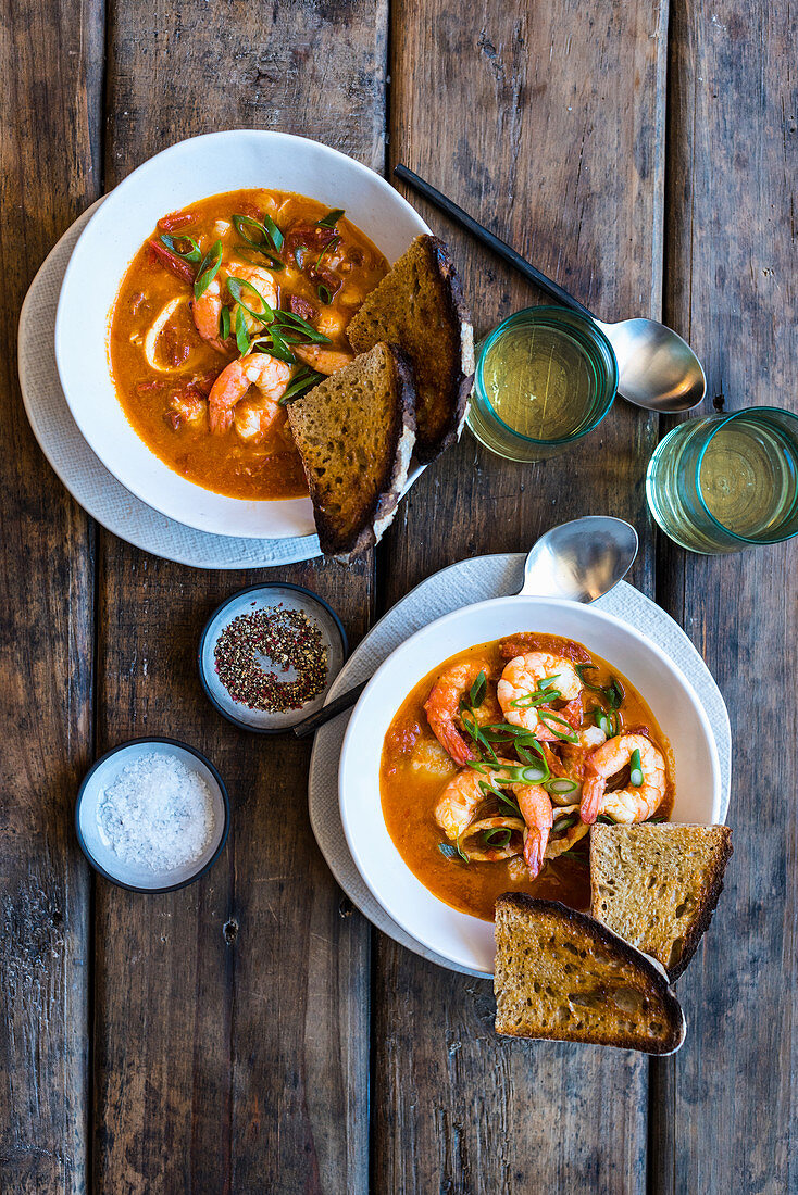 Fish and seafood soup with chorizo, tomatoes and toasted bread