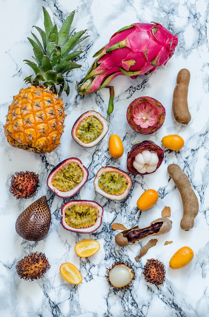 A variety of exotic fruits on a marble background