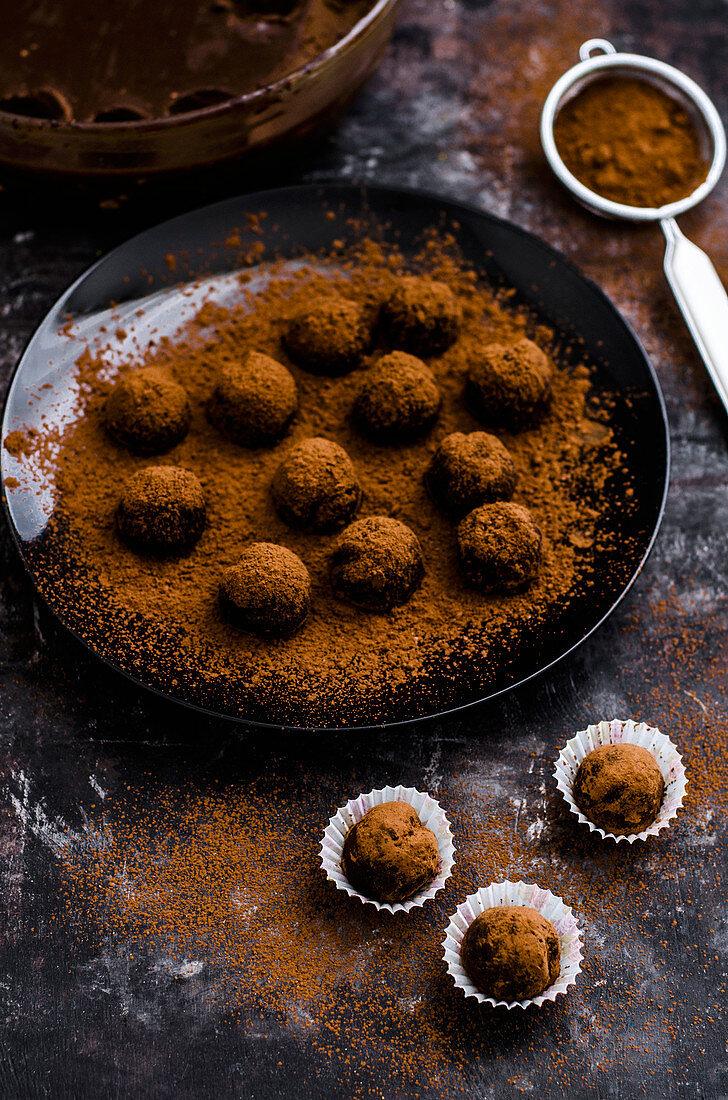 Handmade chocolate truffle balls on a black surface