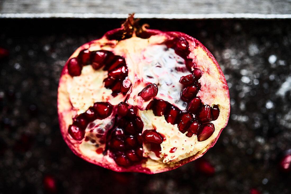 Half pomegranate on metal plate