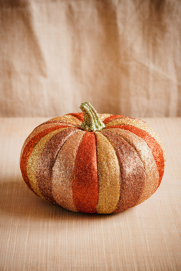 Pumpkin decorated with metallic glitter
