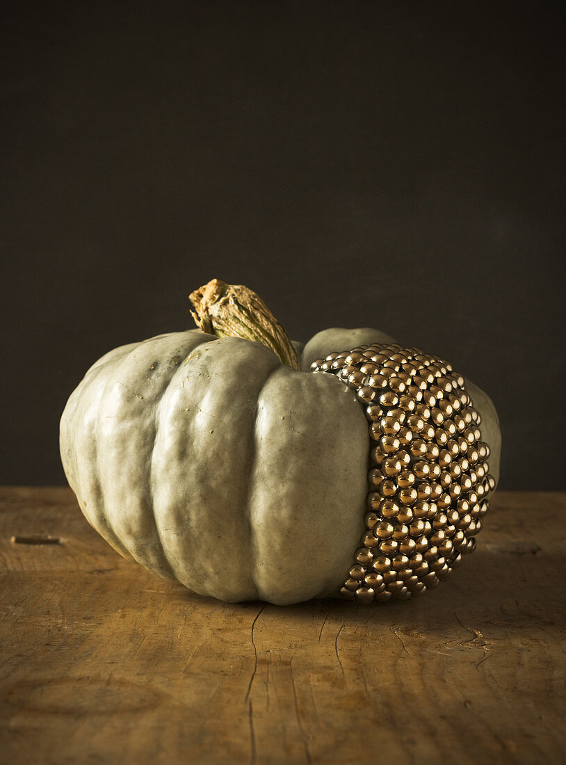 Pumpkin decorated with golden studs