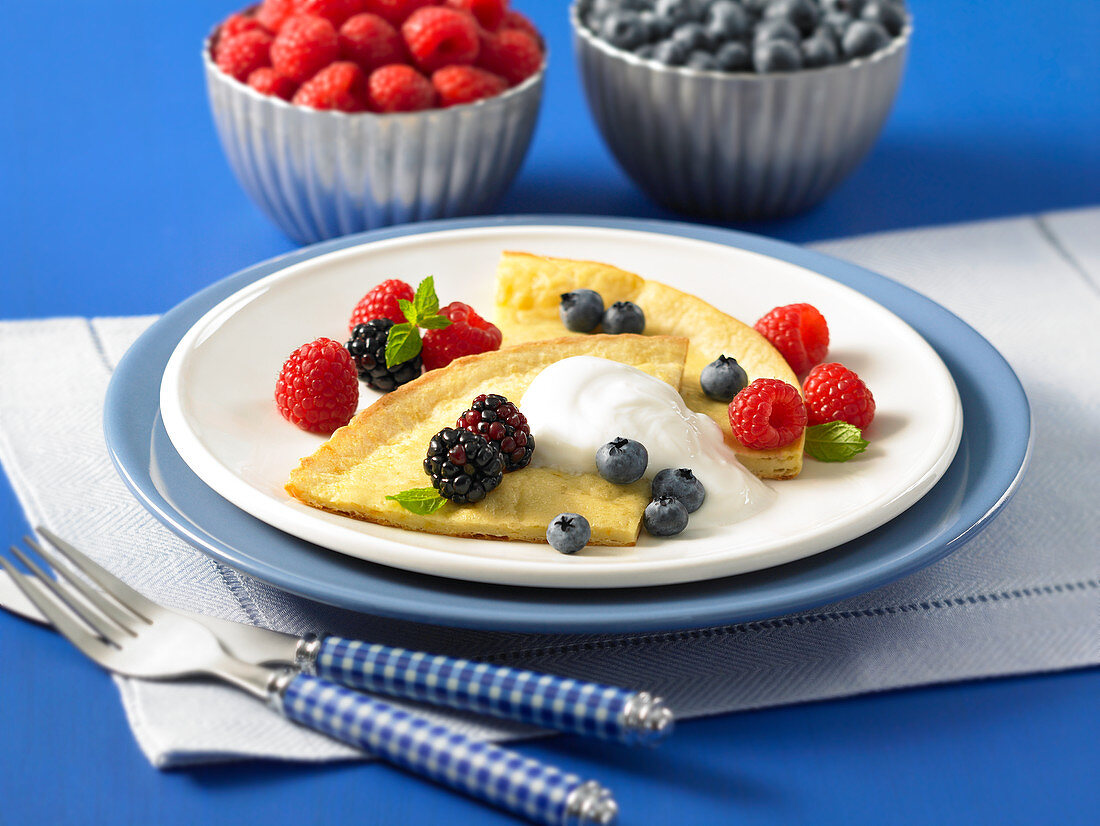 Dutch baby with orange flavouring and berries