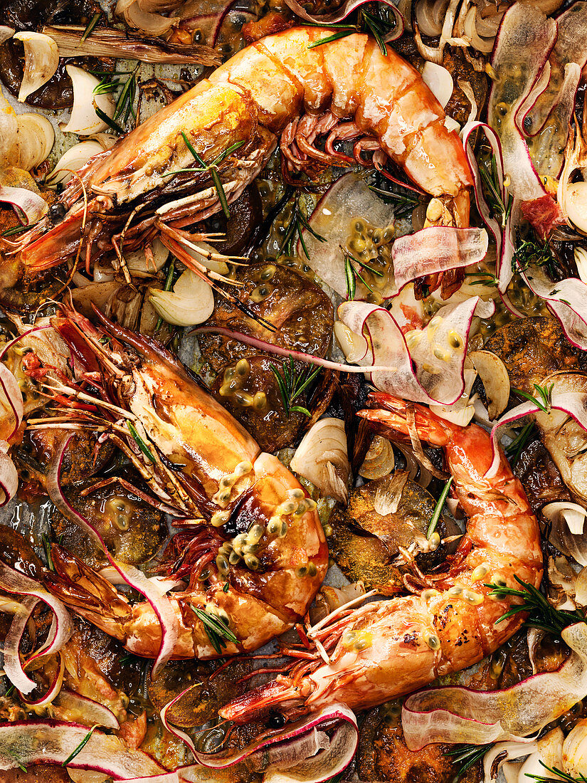 Oven-baked tiger prawns with radish, rosemary and passion fruit