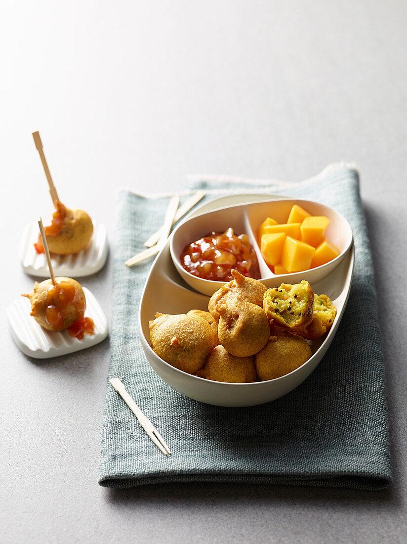 Indian potato balls with mango chutney and mango cubes