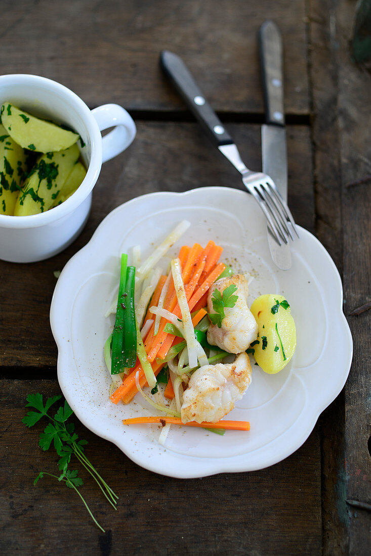 Monk fish on vegetable strips with parsley potatoes